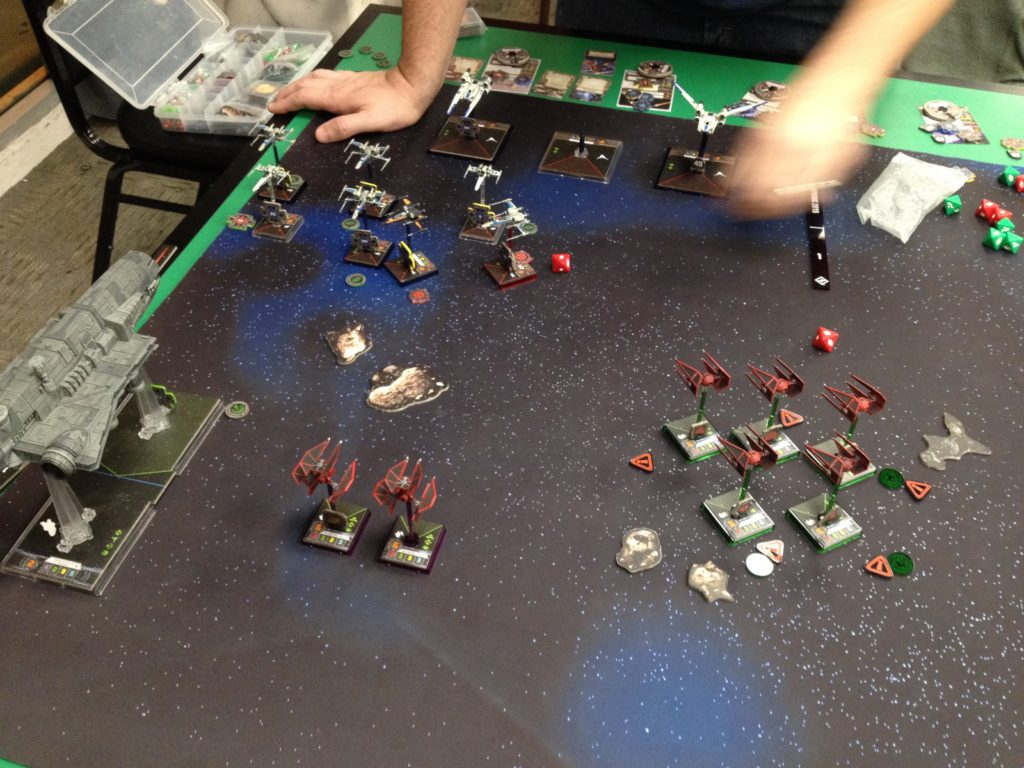 The Gozanti gets focused on as the TIEs pick off enemy ships from afar.