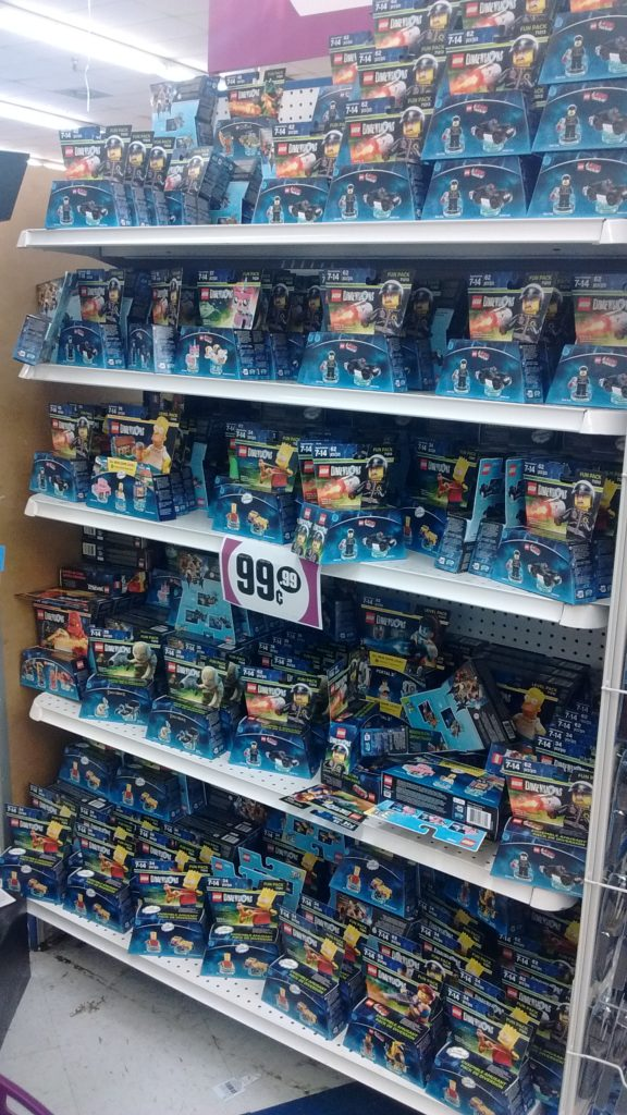 An entire shelf of discounted LEGO Dimensions packs